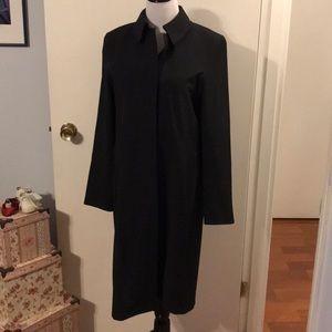 Burberry black raincoat. Classic styling.